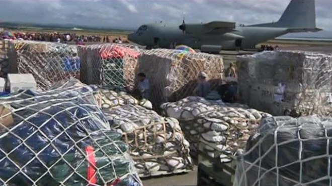 Relief Goods Arrive In Tacloban As Residents Await Aid