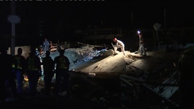 South African Rescue Teams Search For Trapped In Building Collapse