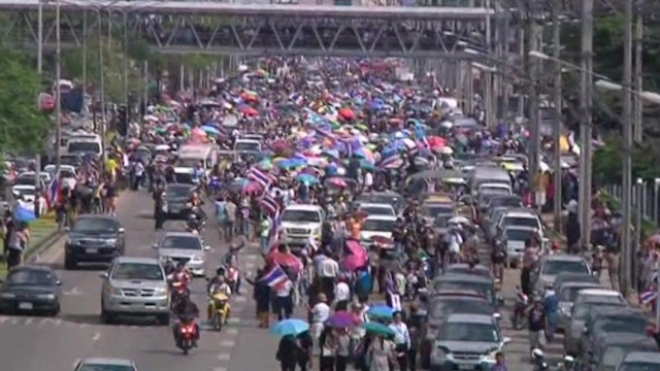 Thai Protesters Swarm Ministries