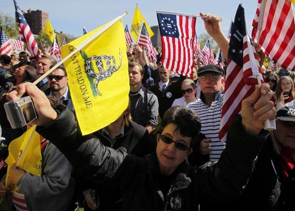 Supporters cheer at a Tea Party Express rally.