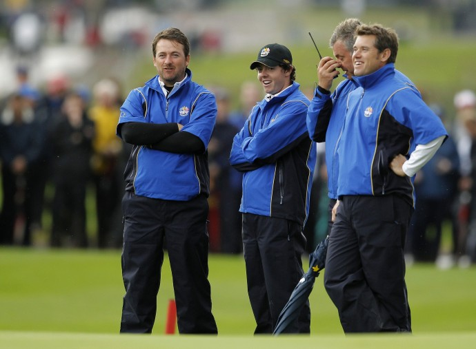 European Ryder Cup player Graeme McDowell (L) of Northern Ireland stands with teammate Rory McIlroy (2nd L), vice-captain Darren Clarke (2nd R) and Lee Westwood