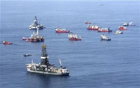 Drill ships and response vessels work in the Gulf of Mexico off the Louisiana coast line