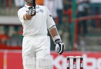India's Sachin Tendulkar reacts after he scored a record of 14,000 test-run during the second day of their second test cricket match against Australia in Bangalore October 10, 2010.