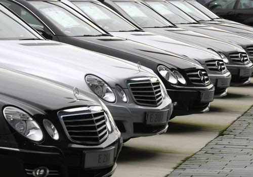 New cars are parked outside the Mercedes-Benz headquarters in Stuttgart
