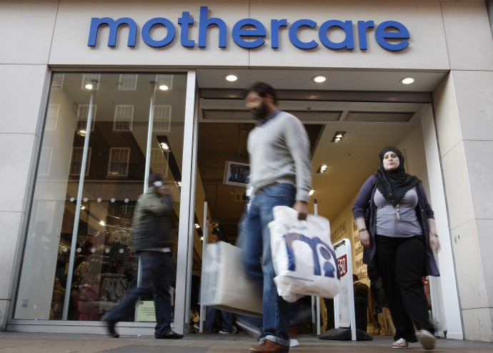 Customers leave a Mothercare shop in London