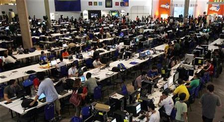 "People surf the web during a ""Campus Party"" Internet users gathering in Sao Paulo"