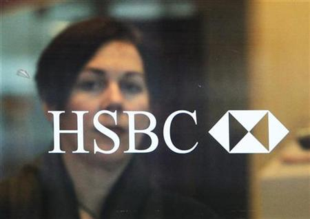 A customer exits an HSBC bank in London
