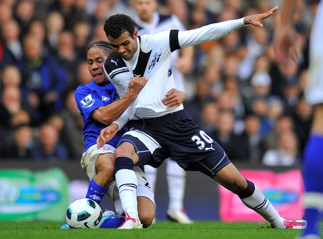 Everton's Pienaar challenges for the ball with Tottenham's Sandro (R) during their English Premier League soccer match in London.