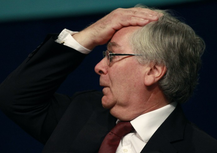 Bank of England Governor Mervyn King gestures during a speech