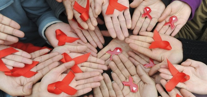 WHO urges focus on HIV patients' human rights on World AIDS Day University students hold red ribbons at a photo opportunity during an HIV/AIDS awareness rally on World AIDS day in Chengdu, Sichuan province more than a year ago on December 1, 2009.