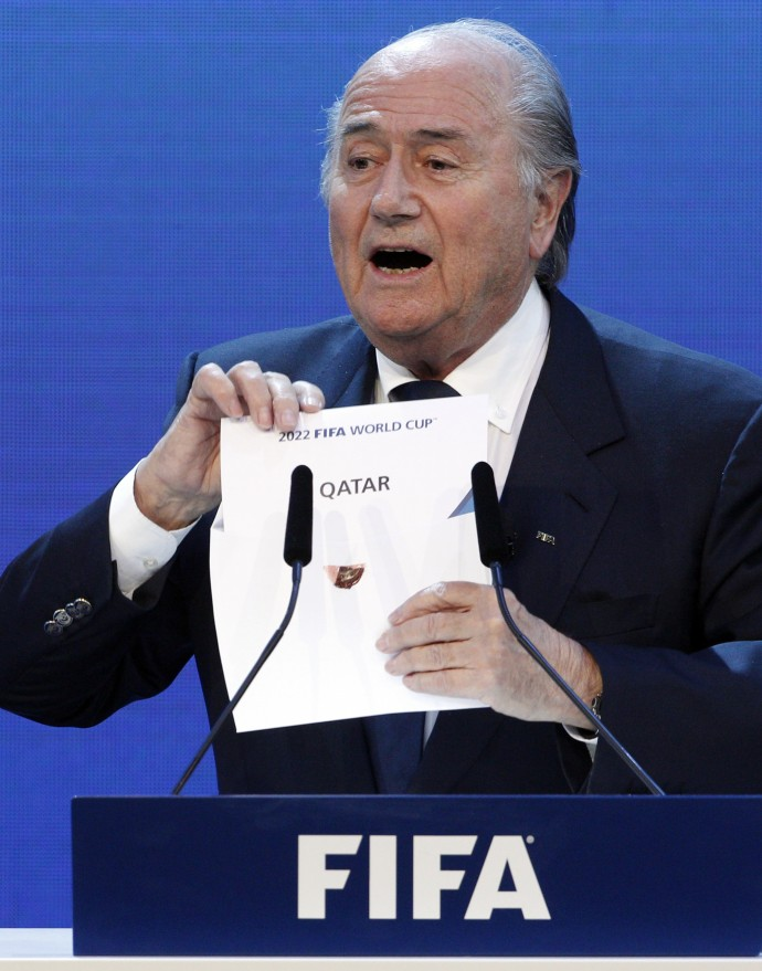 FIFA President Sepp Blatter announces Qatar as the host nation for the FIFA World Cup 2022 in Zurich.