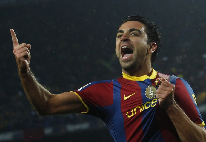 Barcelonas Xavi celebrates after scoring against Real Madrid during their Spanish first division soccer match in Barcelona on 29112010.