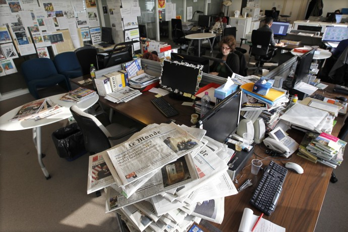 Journalists work in the daily Le Monde newsroom at their offices in Paris
