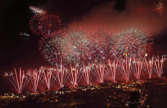 Fire works explode over Funchal Bay in Madeira island during New Year celebrations