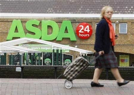 A shopper walks past an Asda superstore in south London, August 13, 2009.