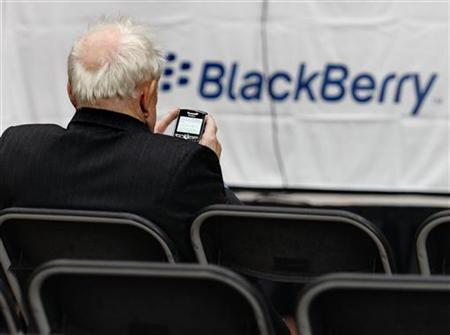 A RIM shareholder uses their Blackberry in Waterloo