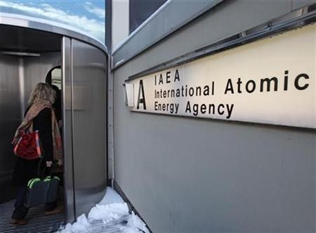 A woman enters the International Atomic Energy Agency (IAEA) headquarters at the UN premises in Vienna