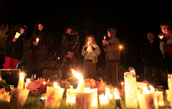 People attend a candlelight vigil at the Tucson University Medical Center after U.S. Representative Gabrielle Giffords (D-AZ) was shot in Tucson, Arizona January 8, 2011. A gunman shot Giffords in the head, seriously wounding her, and killed six other peo