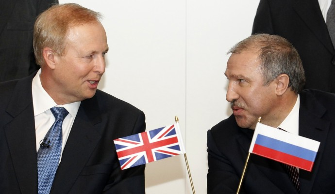 BP Chief Executive Bob Dudley speaks with Rosneft president Eduard Khudainatov before signing an agreement at BP headquarters in London
