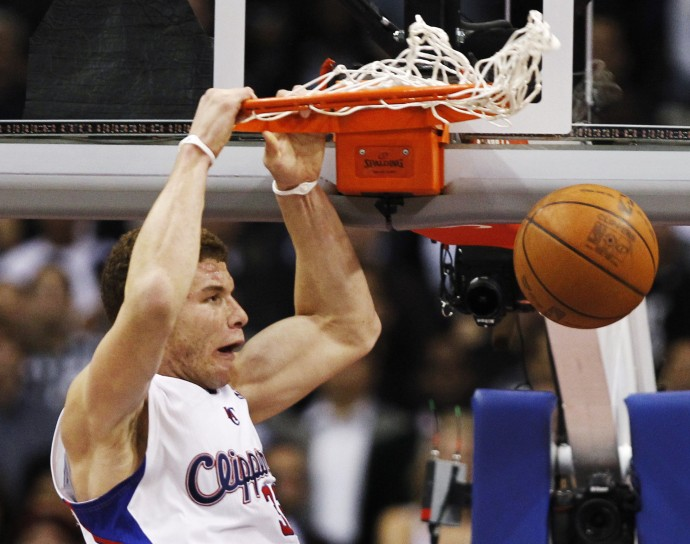 Los Angeles Clippers' Griffin slam dunks against the Miami Heat during their NBA basketball game in Los Angeles