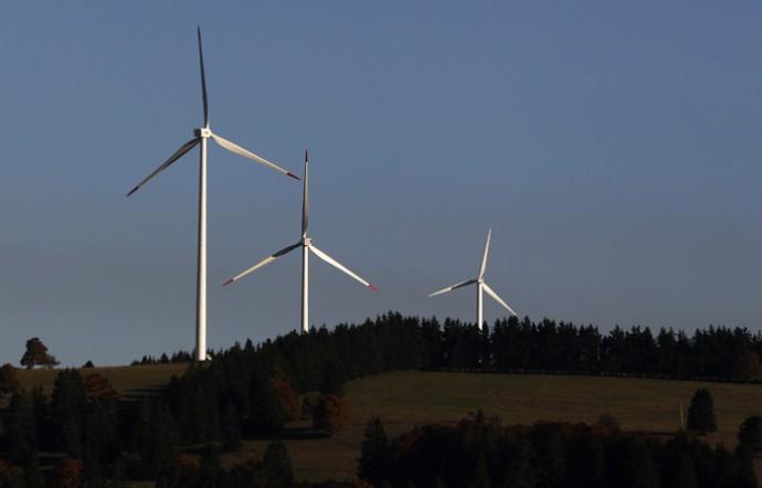 Power-generating wind turbines are seen in a wind farm of BKW in Mont Soleil in the Jura region