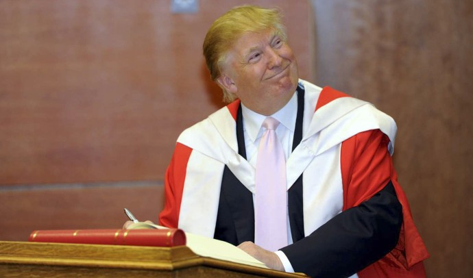 U.S. businessman Donald Trump smiles during a ceremony in which he was awarded an honorary degree, at Robert Gordon University in Aberdeen October 8, 2010.