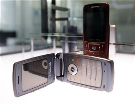 Mobile phones made by Samsung Electronics are displayed at the company's main office in Seoul.