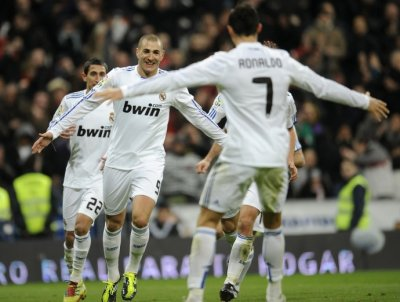Real Madrids Benzema celebrates with Ronaldo after scoring against Mallorca during their Spanish first division soccer match at Santiago Bernabeu stadium in Madrid.