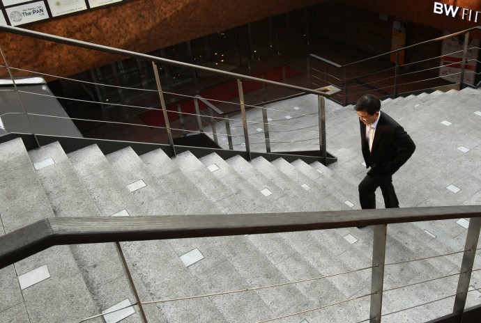 A businessman walks at a financial district in central Seoul