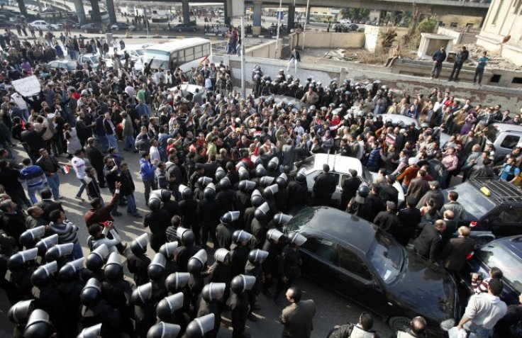 Protesters clash with riot police in downtown Cairo