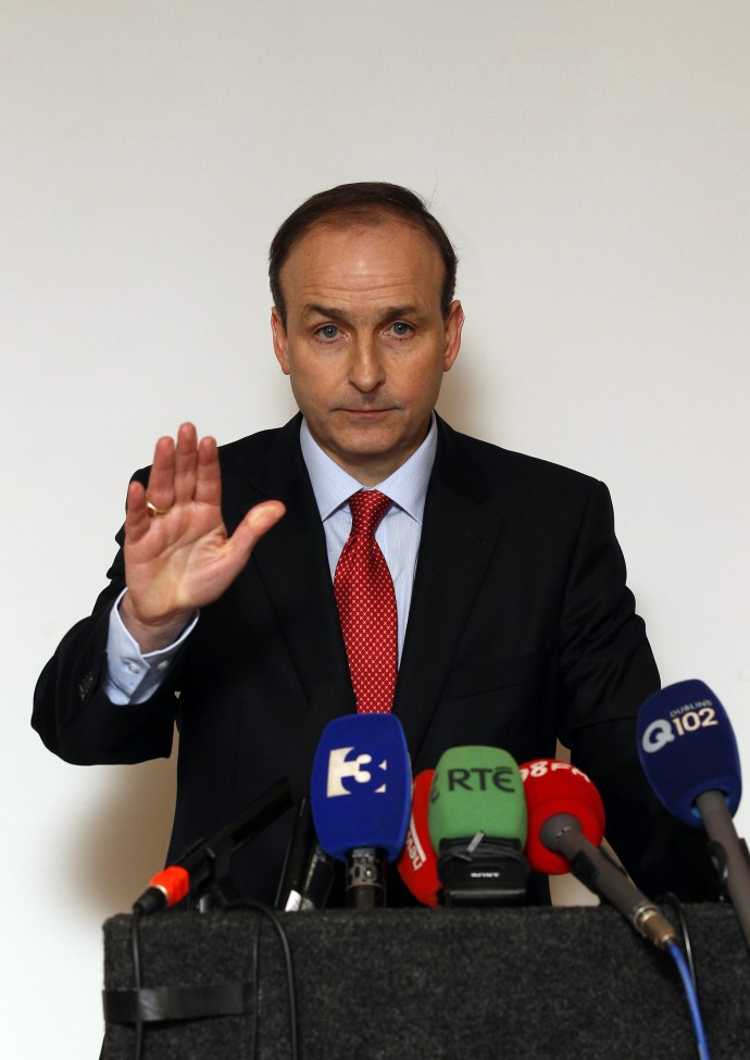 Ireland's Foreign Minister Martin gestures during a news conference at a hotel in Dublin