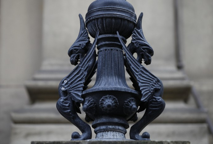 Figures of the Liver Bird, the city's emblem, adorn a lampost outside Liverpool's Municipal Buildings in Liverpool