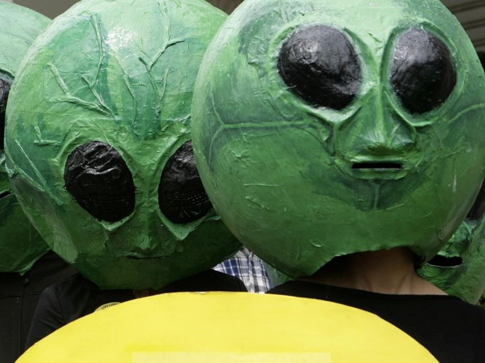 People dressed as aliens