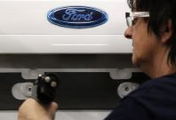 An employee works at the assembly line of the Ford car factory of Saarlouis