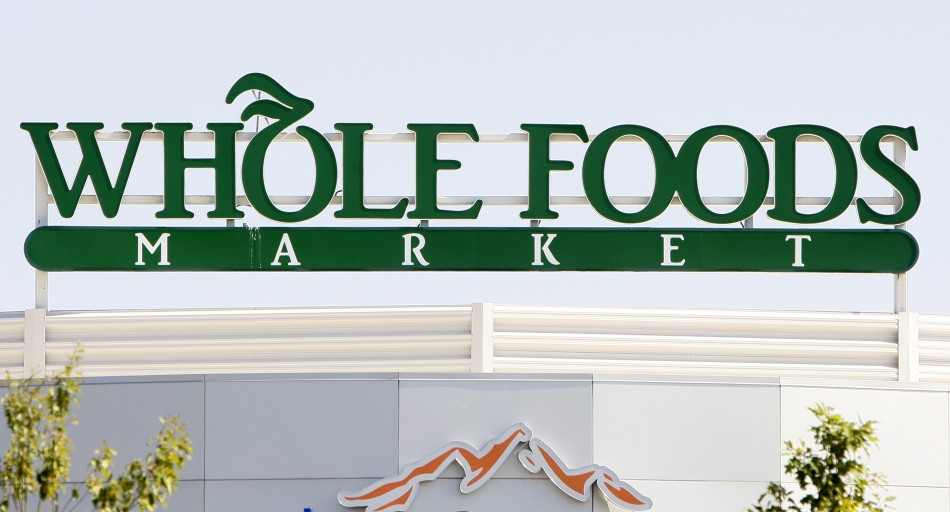 The sign for the Whole Foods grocery store is seen in Lakewood