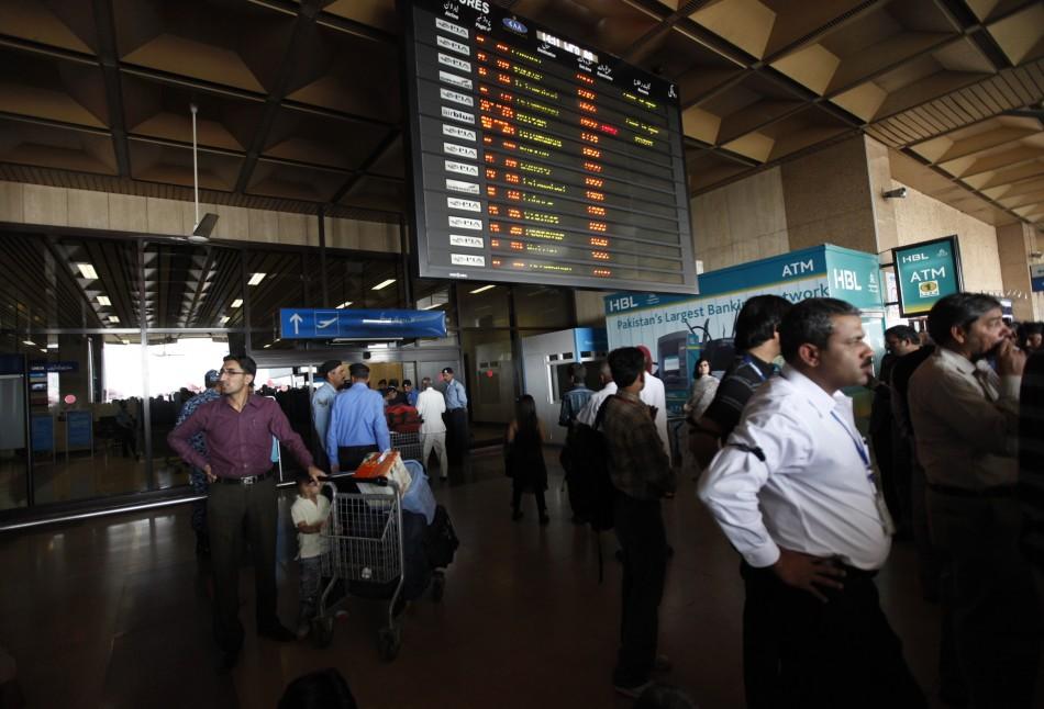 Passengers wait to get on a flight at Karachi's Jinnah International Airport