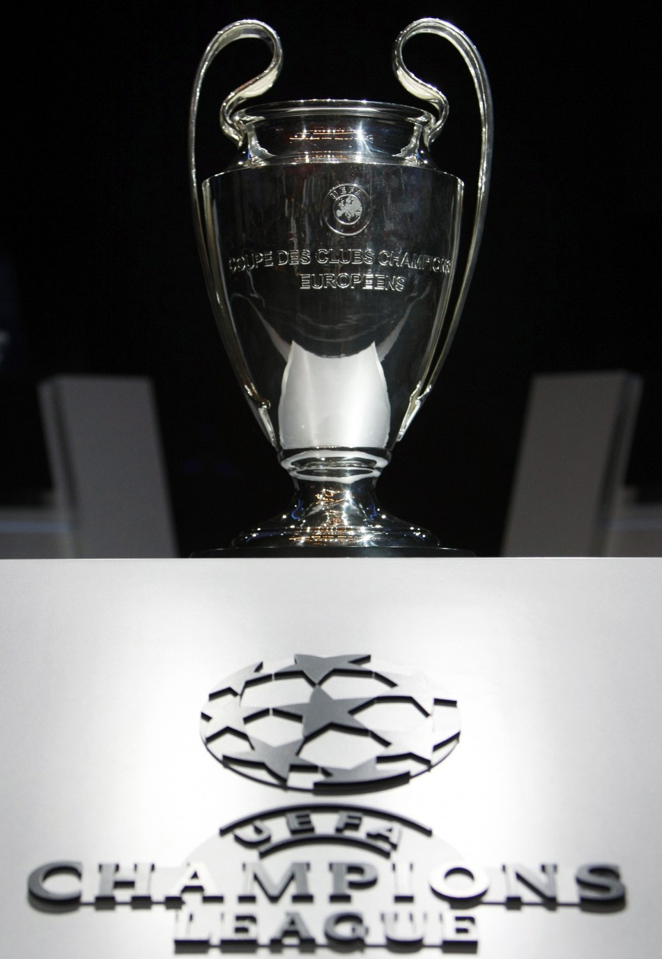 The Champions League trophy is seen during the draw ceremony for the Champions League group stage at Monaco's Grimaldi Forum in Monte Carlo.