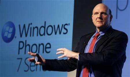 """Microsoft CEO Ballmer gestures during the """"Windows Phone 7"""" presentation at the Mobile World Congress in Barcelona"""