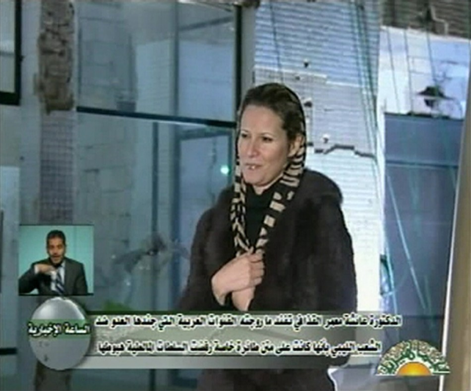 Libyan leader Muammar Gaddafis daughter Aisha speaks during an interview on state television, in this still image taken from video