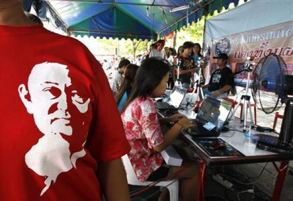 A woman wearing a t-shirt with a picture of former Prime Minister Thaksin Shinawatra