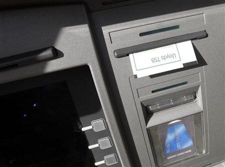 A receipt hangs from a Lloyds TSB Cashpoint machine in Loughborough