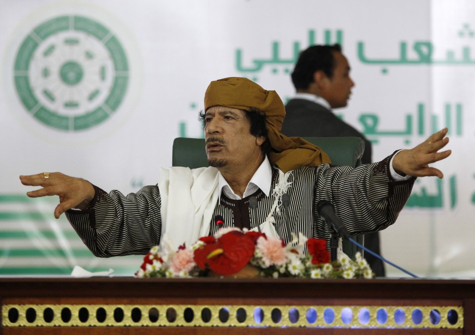 Libyas leader Muammar Gaddafi gestures to his supporters in Tripoli