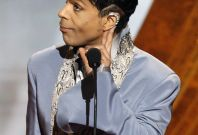 Prince gestures on stage at the 42nd Annual NAACP Image Awards at the Shrine auditorium in Los Angeles March 4, 2011.