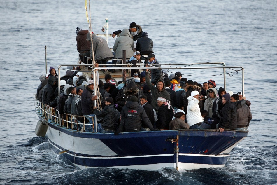 Migrants from North Africa arrive in the southern Italian island of Lampedusa