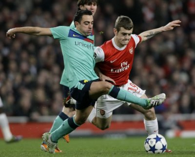 Xavi and Wilshere battle for the ball in the first leg of the tie.