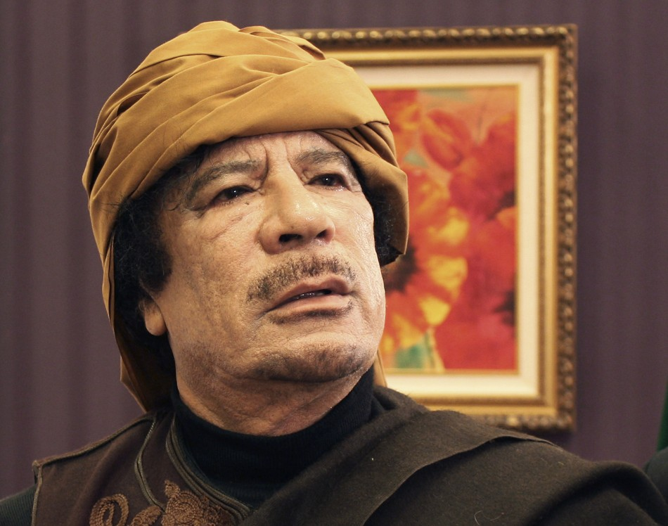 Libya's leader Muammar Gaddafi poses after an interview with TRT Turkish television reporter Mehmet Akif Ersoy at the Rixos hotel in Tripoli March 8, 2011. P