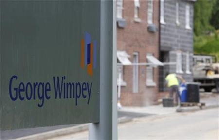 A George Wimpey sign is seen at a building site in Groby, central England