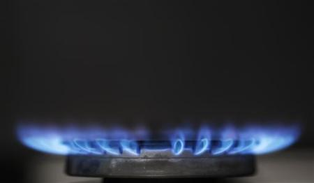 Gas flames are seen burning on a cooker in London