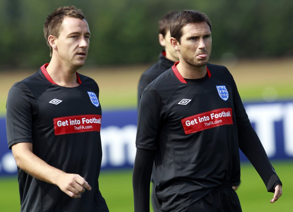 England soccer players John Terry and Frank Lampard walk on the pitch during a training session at London Colney.