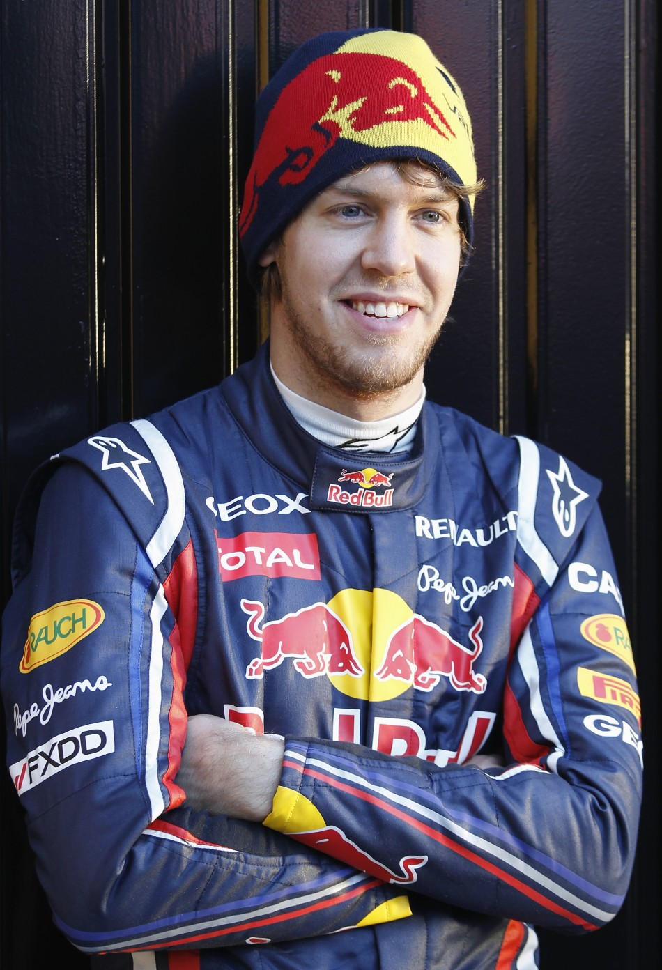 Red Bull Formula One driver Sebastian Vettel of Germany poses for the media in Valencia.